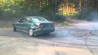 BMW E36 318i M43B18 Drift donut with flat tyre.