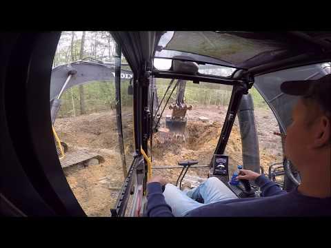 Excavators Pulling Out Stumps