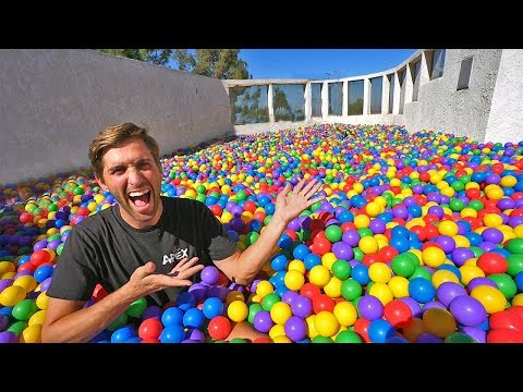 Hide and seek in 200,000 ball pit! on our rooftop