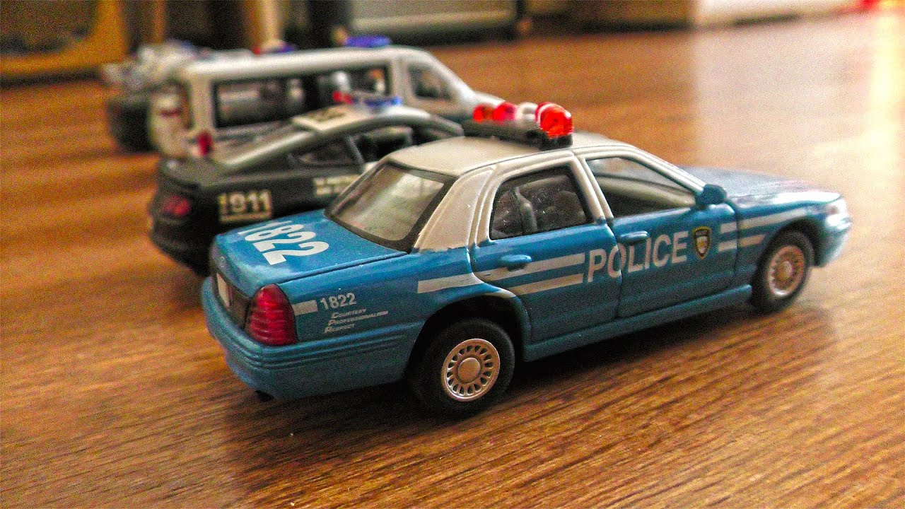 Police Miniature Cars Pushed by Hand