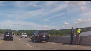 Traffic is backed up on McClugage Bridge because of something.