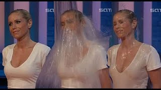 Good looking blonde woman soaked to the skin in nice white dress