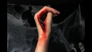 How to do a slit hand cut fwith FX makeup