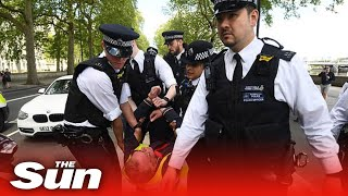 5G coronavirus conspiracy theorists stage anti-lockdown protest outside London police HQ