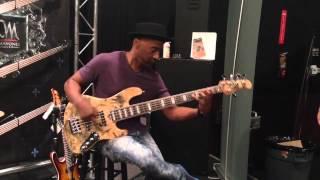 Marcus Miller trying out the Mayones Jabba 5 Custom Shop Buckeye Burl