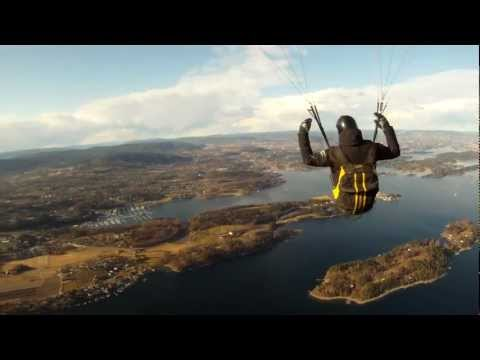 paraglider towing over oslo fjord
