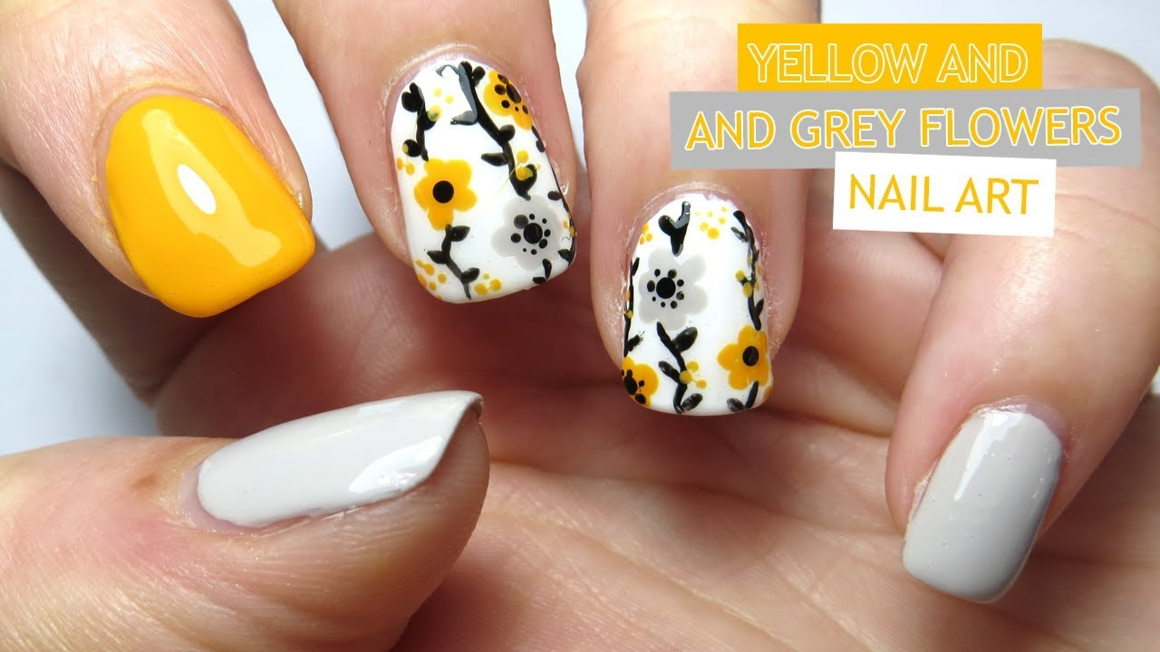 yellow and grey flowers nail art