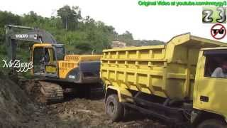 Dump Truck Mitsubishi Colt Diesel 120Ps Being Loaded By Volvo EC210B