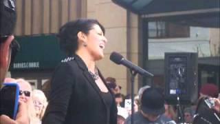 Sara Ramirez sings