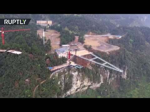 'Between Earth & Sky': 300-meter-high, 80-meter-long skywalk opens in China
