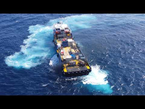 4k video Crew boat rolls coal sweet exhaust sound backing up to the platform.