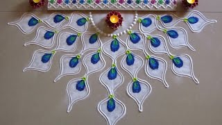 Easy peacock feather rangoli design for diwali | Innovative rangoli designs by Poonam Borkar