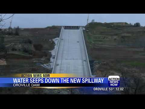 Water seeps down Oroville Dam spillway