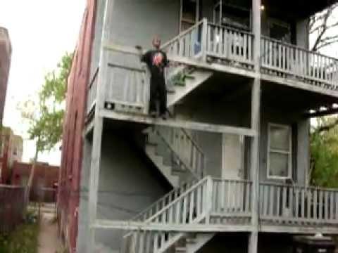 boy jump 0ff a house backyard tumbling don't try dis at home