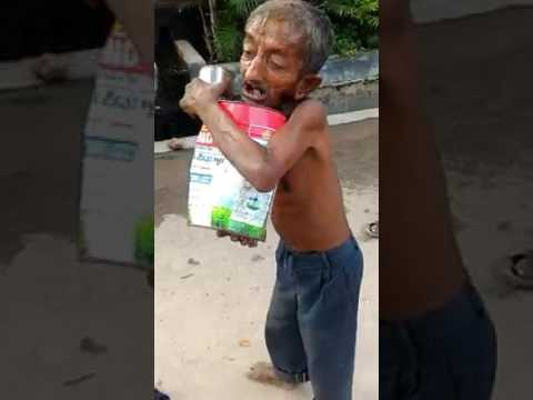 "a beggar singing indian bollywood movie song ""aaja tujhko pukare mere git re mere mitwa'"