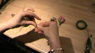 Wedding Flowers - How to make a wired rose buttonhole for a wedding - Campbell's Flower School(Part of my 'How to' series, in this video I show you how to make a simple wired buttonhole by wiring and taping a rose, an ivy leaf, some wax flower and some ..., 2012-02-02T21:06:46.000Z)
