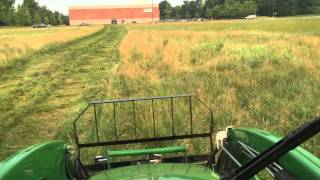 John Deere 4720 with 7 foot Kodiak rotary cutter mowing bush hog