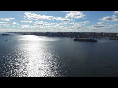 A container ship pilots through the Port Of Halifax