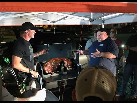 Pitmaster Chad Ward and Dud cooking hogs on the Traeger