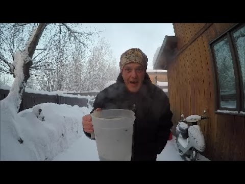 Throwing water into the air at -52 below zero in fairbanks Alaska