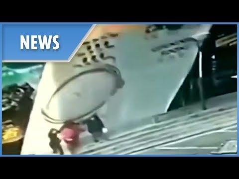 Falling billboard injures four people in northeast China