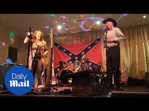 Bruce Jones performs on stage in front of Confederate flag - Daily Mail