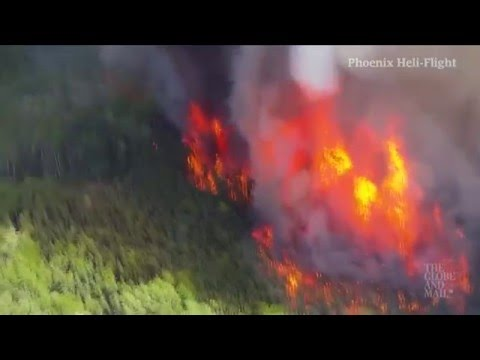 Helicopter footage shows wildfires continuing to rage southwest of Fort McMurray