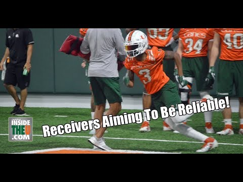 Miami Hurricanes Wide Receivers Catch Short Passes in Drill