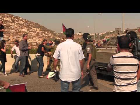 Israeli Soldier Spits On Palestinian Flag