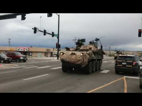 Soldiers Haul Equipment, Razor Wire In Colorado with Military Helicopter Escort