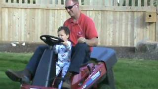 Jonathan mowing the lawn