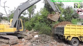 Overloaded Dump Truck By Volvo EC210B Excavator