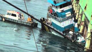 Tug Boat becomes pinned under Bridge