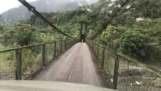 Crossing a narrow suspension bridge