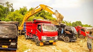 Overloaded Dump Truck By Old CAT Excavator