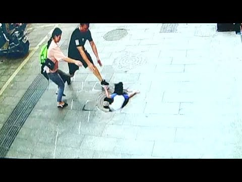 Curious Boy Falls Into Manhole In Southwest China City