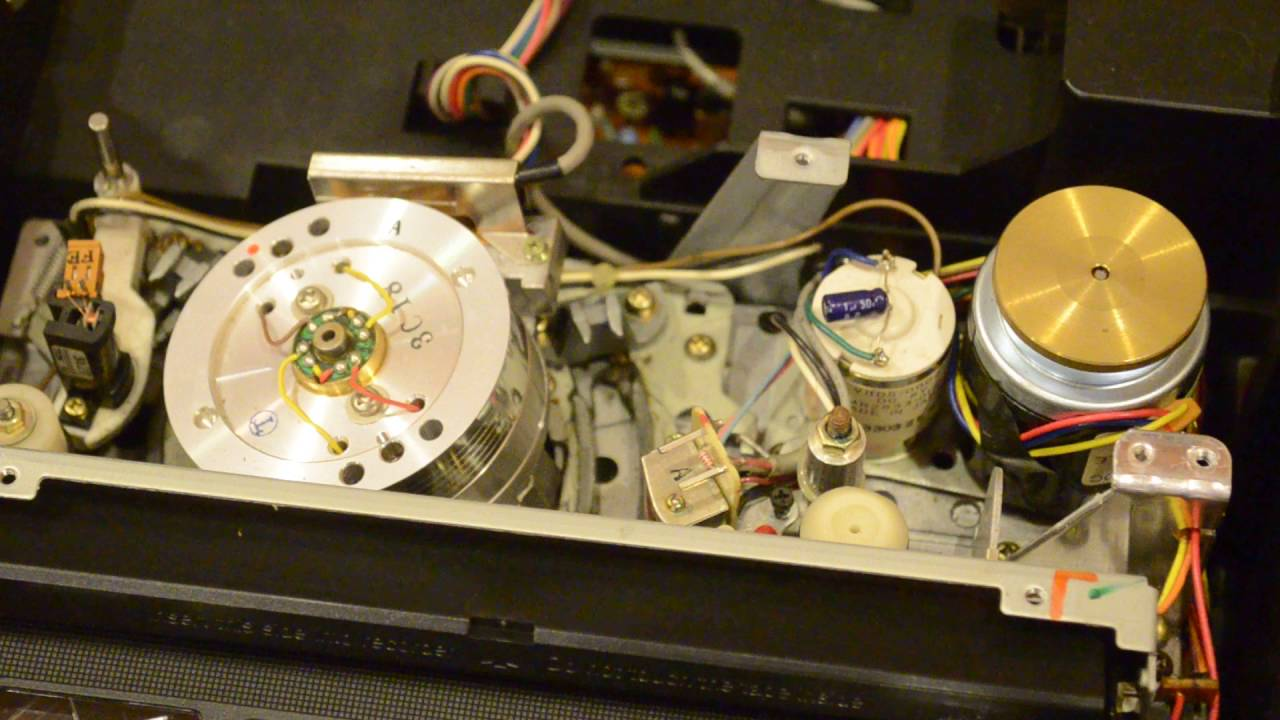 Magnavox VCR loading a VHS tape