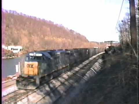 CSX & Seaboard power Q396, while a Chessie helper ties on at S. C-ville. 2/20/1990 Travel Video