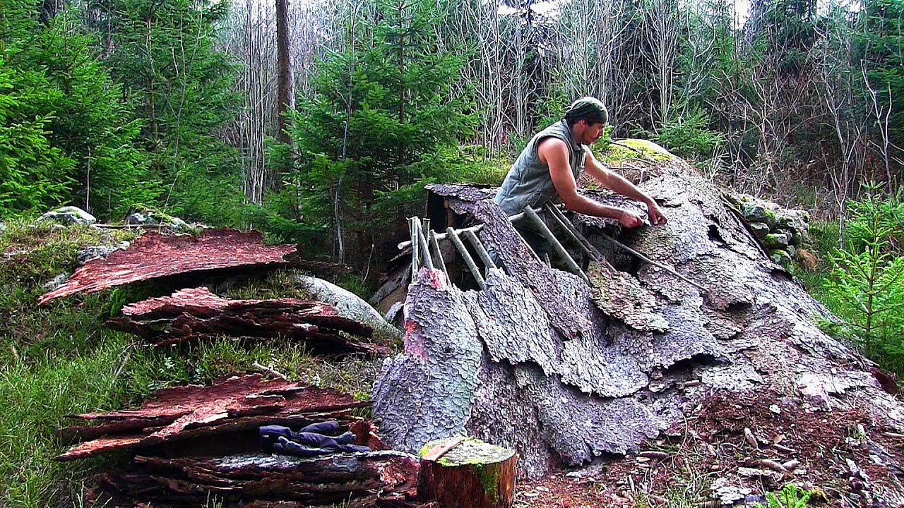 Building A Bushcraft Camp Part 2 Roof And Fire Pit