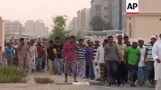 As Muslim families gather at sunset during Ramadan, millions of workers are separated from their hom