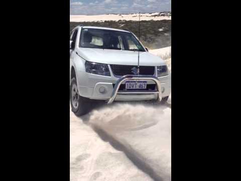 Bogged Grand Vitara in sand