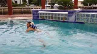 Maltese Poodle-unbelievable!!! Baby Maltese Poodle Jumping On Owner's Back For A Swim.