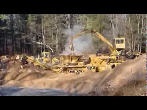 Grinding logs for mulch