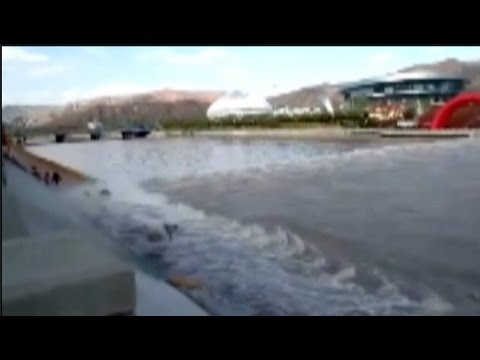 Rising river water sweeps pedestrians off their feet in northwestern China