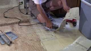 Removal of Armstrong linoleum w/ clean removal of all adhesive
