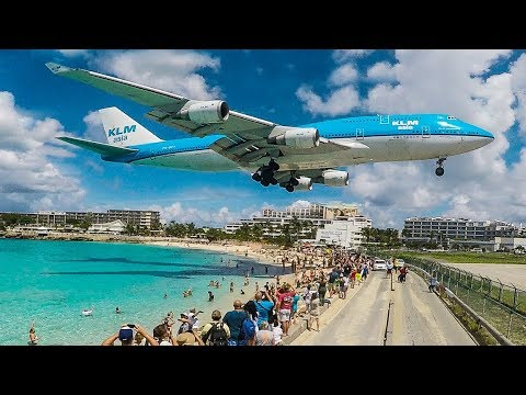 BOEING 747 low LANDING above THE BEACH - St Maarten and Maho Beach (4K)