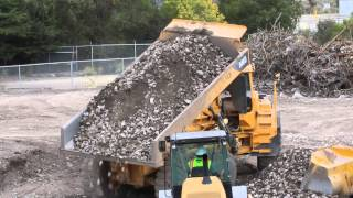 Volvo A40D Articulated dump truck dumping a load of rocks and dirt then being filled up by a Volvo E