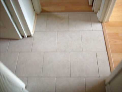... of flooring 12x12 porcelian tile, and laminate flooring - YouTube