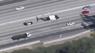 Police chase armed robbery suspect through LA streets, freeways