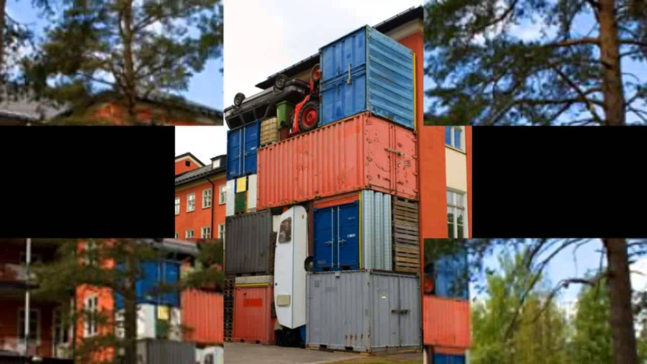 Shipping Containers and Cars Stacked High as Colorful Eco Sculptures!